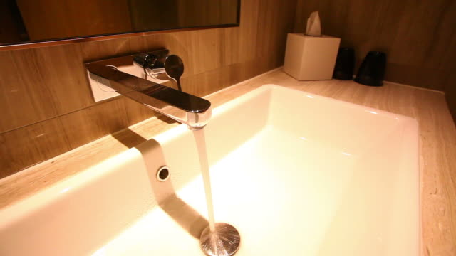 Dolly shot of water faucet in a luxurious hotel room video