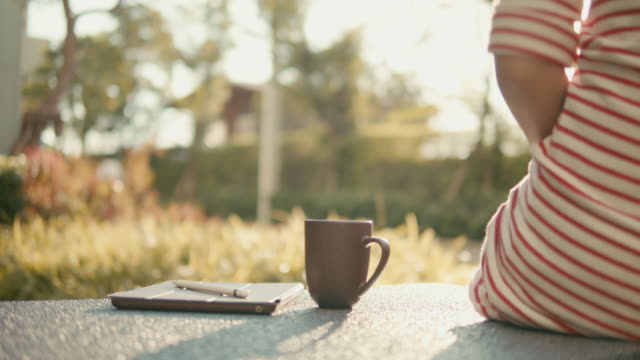 Dolly shot of woman drinking tea in the morning,Slow motion Dolly shot of woman drinking tea in the morning,Slow motion cup stock videos & royalty-free footage