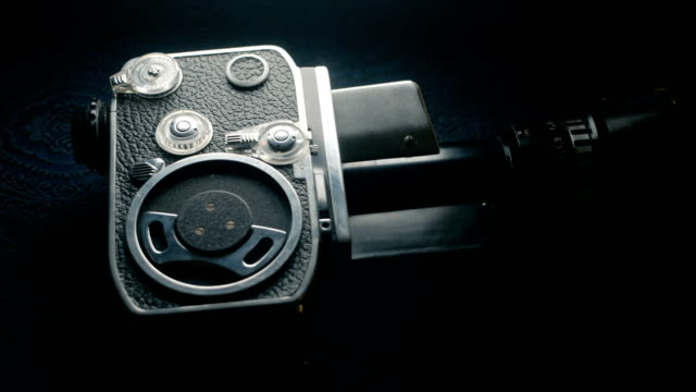 dolly shot: old-fashioned vintage analog 8mm classic movie camera - analogico video stock e b–roll