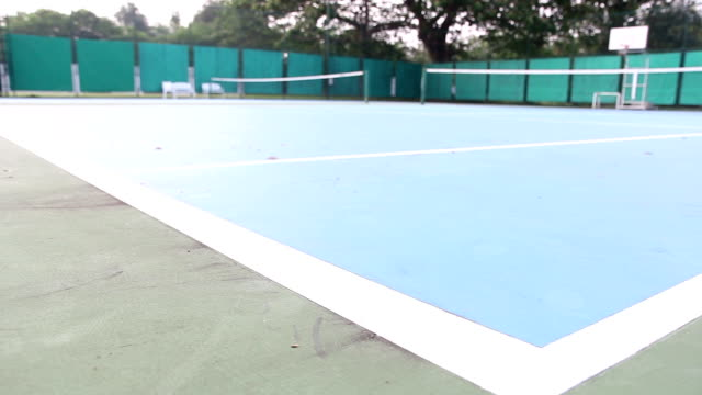 Dolly shot on tennis court in the morning video