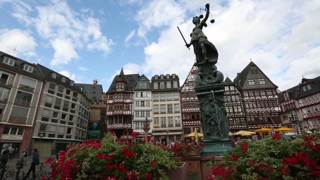 Dolly shot: Pedestrian crowded at Romerberg Town square Frankfurt Germany video