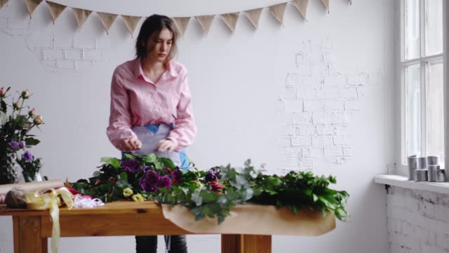 Dolly shot: professional florist artist at work Dolly shot: professional florist artist at work. 4k saleswoman stock videos & royalty-free footage