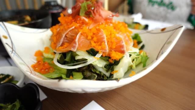 Dolly shot salmon sashimi salad on white bolw Dolly shot salmon sashimi salad on white bolw shrimp seafood stock videos & royalty-free footage