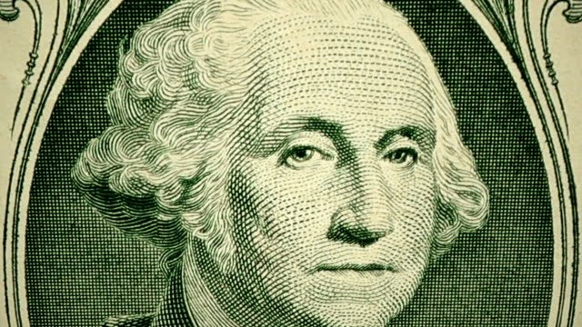Dolly shot showing extreme detail of George Washington's engraving on the $1 dollar bill Extremely close dolly shot of $1 dollar bill showing the detail of the engraving of George Washington us paper currency stock videos & royalty-free footage