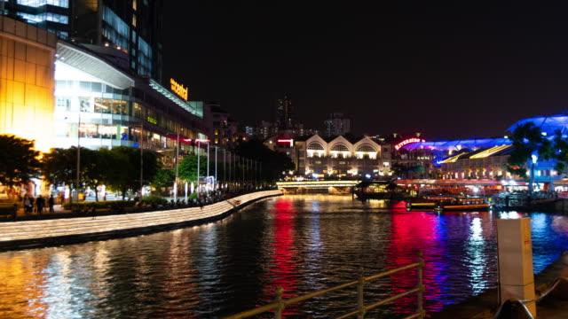 Dolly shot time lapse Clarke Quay riverbank night