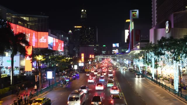 Dolly shot wide time lapse night of traffic and famous mall in business district Bangkok,Thailand The night rush hour transportation traffic time lapse stock videos & royalty-free footage