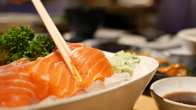 dolly shot:eating salmon sashimi - seafood stock videos and b-roll footage