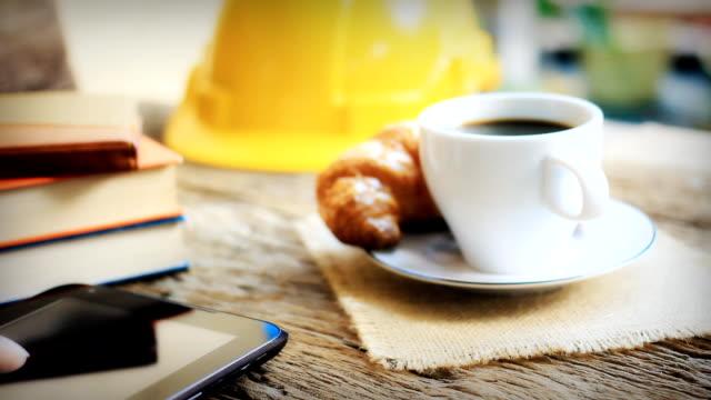 Dolly shot:Engineer having coffee break. video
