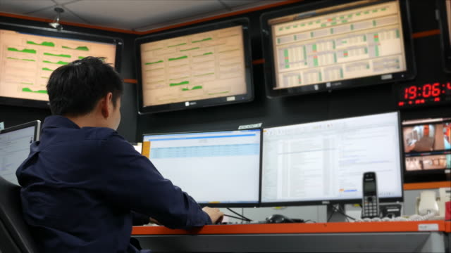 Dolly shot:Youngman working in a control room video