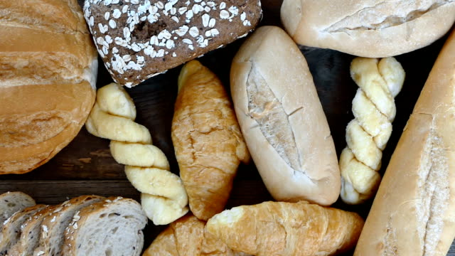 HD Dolly, top view of various breads and baked goods. video
