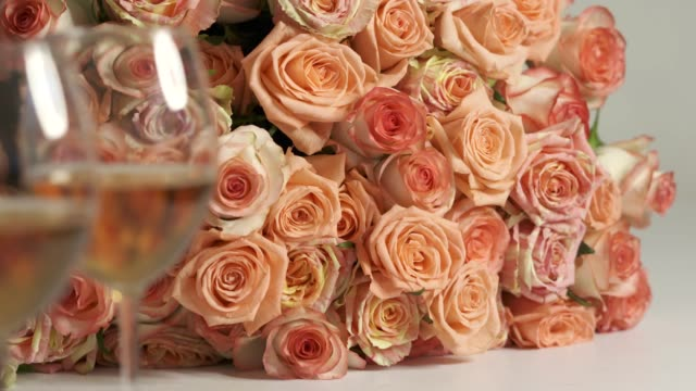 Dolly: Two glasses of wine and extra large bouquet of pink roses