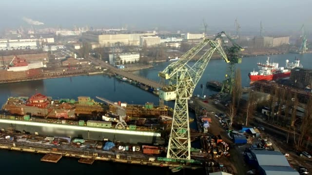 Dolly Zoom Aerial Of Shipyard Cranes Docks Harbour video