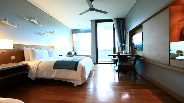 Dolly:Bed in a tropical resort hotel room with terrace video