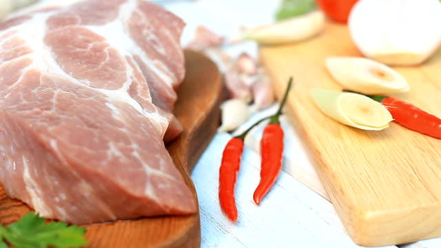 HD dolly:fresh pork chop on wood board with Condiment. video