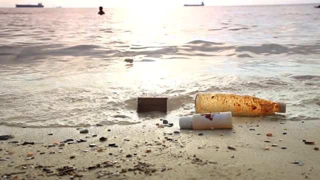 HD DOLLY:garbage that floated up on the beach. video