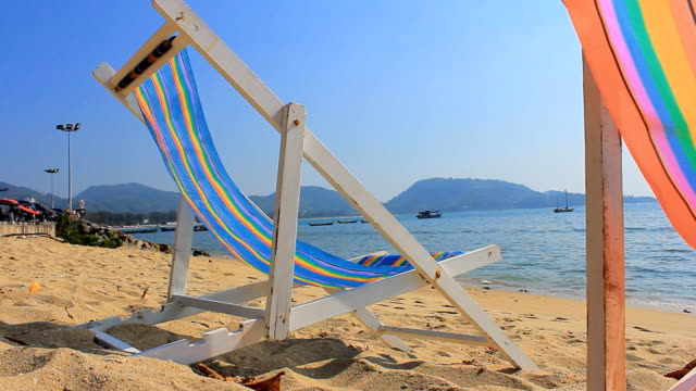 HD DOLLY:Sun chairs on sandy beach video