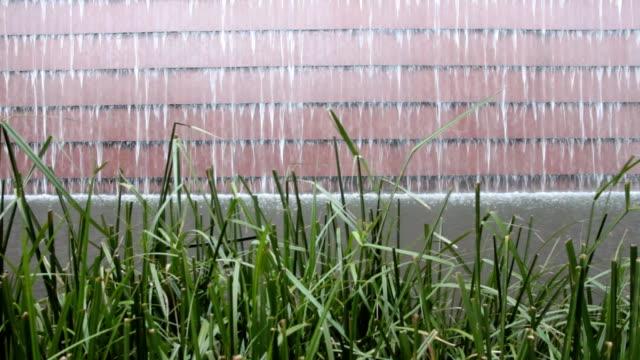 Dolly:waterfalls rock wall in garden footage video