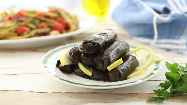Dolma dish on a table served by the chef video