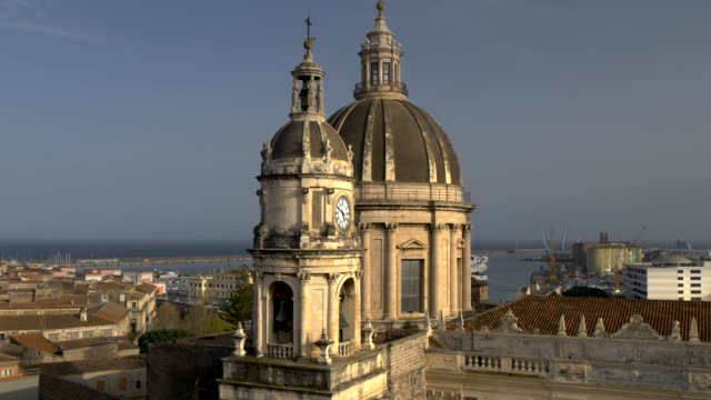 Dome and Belltower of Saint Agatha Cathedral in Catania. Sicily, Italy. Zoom out shot video