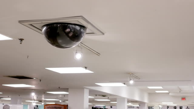 dome security camera on top of ceiling - soffitto video stock e b–roll