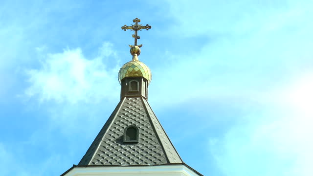 Dome with a cross of an orthodox temple against the sky with clouds video