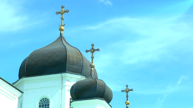 Domes of orthodox church against the sky with clouds video