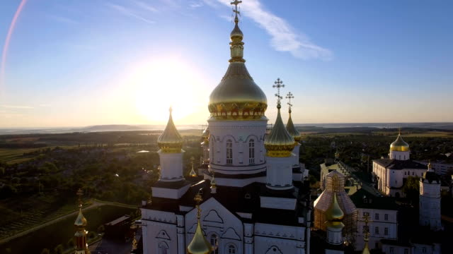 domes of the church at sunrise. aerial shooting from quadrocopter above the sky - cathedrals stock videos & royalty-free footage