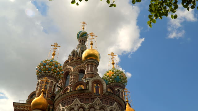 Domes of the Church of the Savior on Blood on a background of white clouds video
