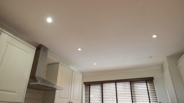 domestic kitchen interior - waschmaschine wand stock-videos und b-roll-filmmaterial