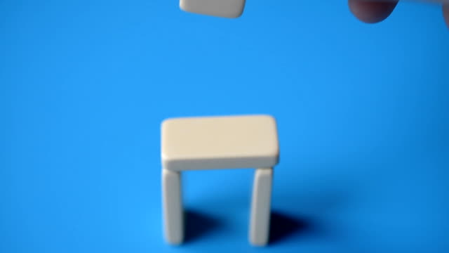 Domino chips construction on a blue background video