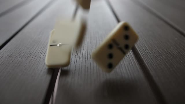Domino Tiles Falling on Table Slow Motion
