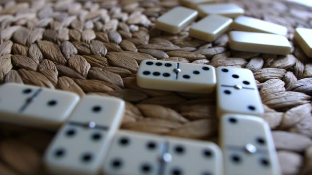 Domino Tiles Laid on Table During Game of Dominoes