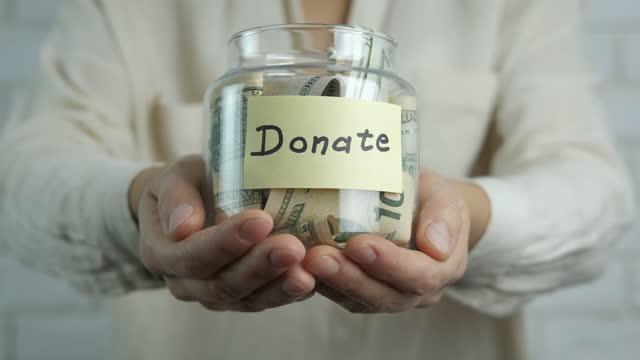 vídeos de stock e filmes b-roll de donate finance. - benefits