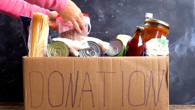 donations-och välgörenhets koncept - välgörenhet bildbanksvideor och videomaterial från bakom kulisserna