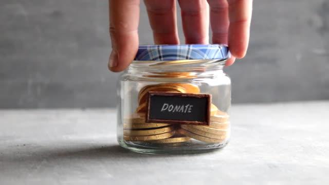 Donation box. Donate, giving money idea. video