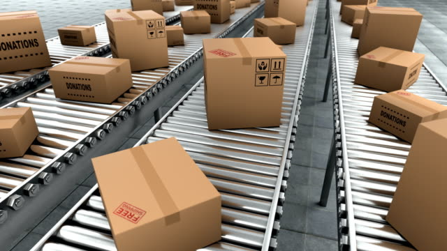 Donation in the cardboard boxes which moving on conveyor belt, seamless loop video