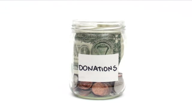 Donations - HD HD 1080i Adding money to donation jar jar stock videos & royalty-free footage