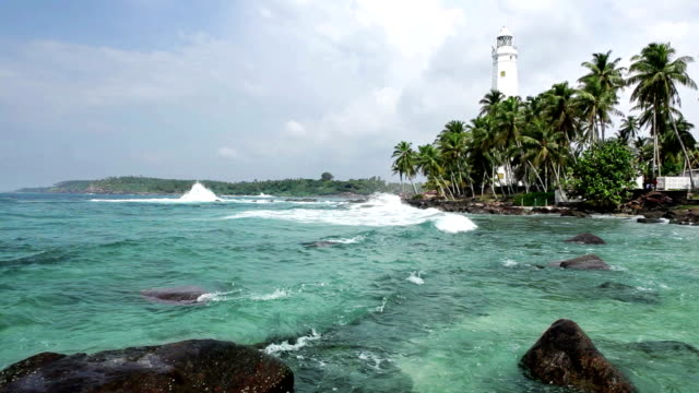 Dondra lighthouse - the southern point of the Sri Lanka island washed by the Indian ocean waves. Dondra lighthouse - the southern point of the Sri Lanka island washed by the Indian ocean waves. sri lankan culture stock videos & royalty-free footage
