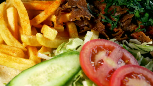 doner kebab meat with pommes frites - spiedino video stock e b–roll