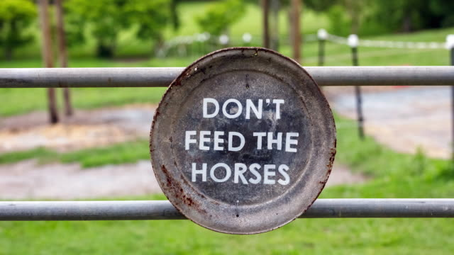 Don't Feed The Horses Sign On Farm Gate
