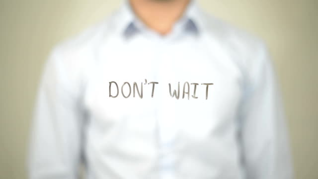 Don't Wait, Man writing on transparent screen video