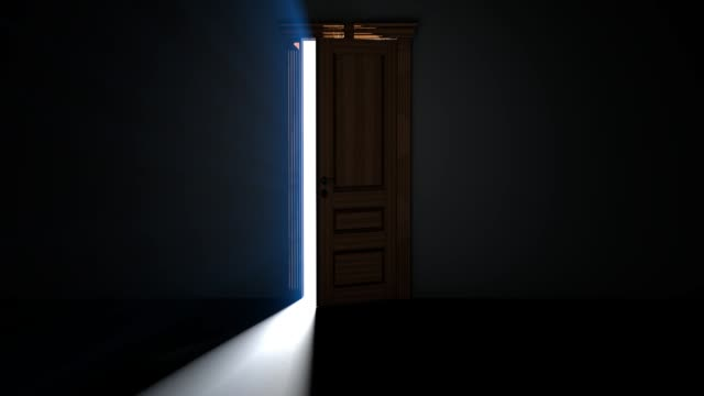 Door in a dark room opens and fills the space with bright white light