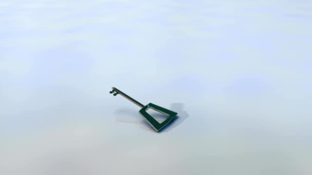 Door key ,isolated, is falling on the floor video