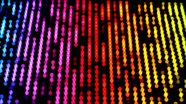 Dots moving down in a row, abstract colorful composition closeup view, loop able 4k horizontal video background