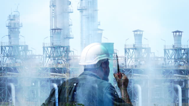Double exposure engineer with Oil refinery emitting greenhouse gases. video