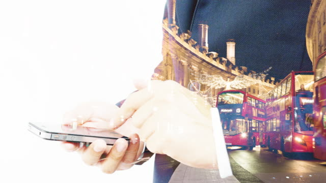 Double exposure man using mobile smart phone. video