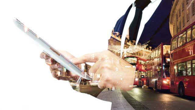 stockvideo's en b-roll-footage met dubbele blootstelling man met behulp van tablet pc. - dubbelopname businessman