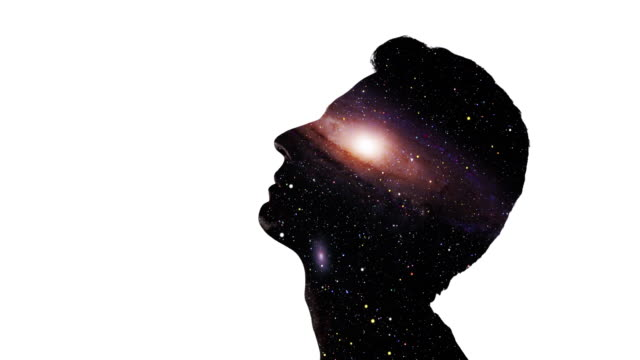Double exposure: Man's face and galaxy