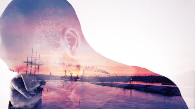 double exposure av solnedgången och ung man - gothenburg bildbanksvideor och videomaterial från bakom kulisserna