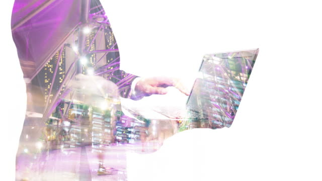 stockvideo's en b-roll-footage met dubbele blootstelling-zakenman werken op een laptop. - dubbelopname businessman
